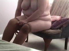 Shy Large Woman Puts On Her Pantyhose