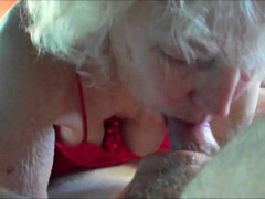 Horny grandma giving head to a young dick