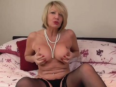 Blonde mature Amy masturbating herself