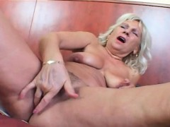 Blonde mature fingering and toy fucking herself