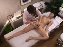 Ravishing Oriental babe with perky titties gets massaged an