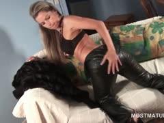 Stunning blonde mature stripping erotically at home