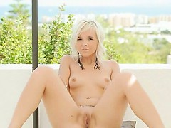 charming blonde making outdoor strip