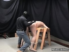 Horny gay dude gets bound bay a masked dude and is spanked