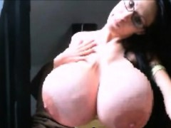 Sexy brunette with huge silicone tits On Webcam