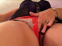 Fat MILF rubs and fingers her hairy pussy