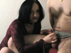 Enticing housewife strokes a long dick until it explodes wi