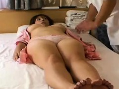 Busty Japanese girl with sexy legs gets ready for a relaxin