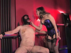 Mistress dominates bound sub with gloryhole