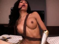 Wonder Woman ladyboy with big tits fucks a guys ass