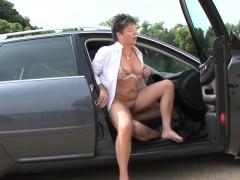 Chubby German mature fucks in the car