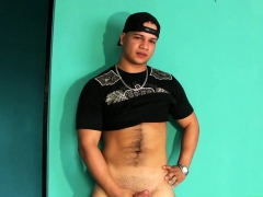 Jocky young Latino tugging his huge curvy cock until climax